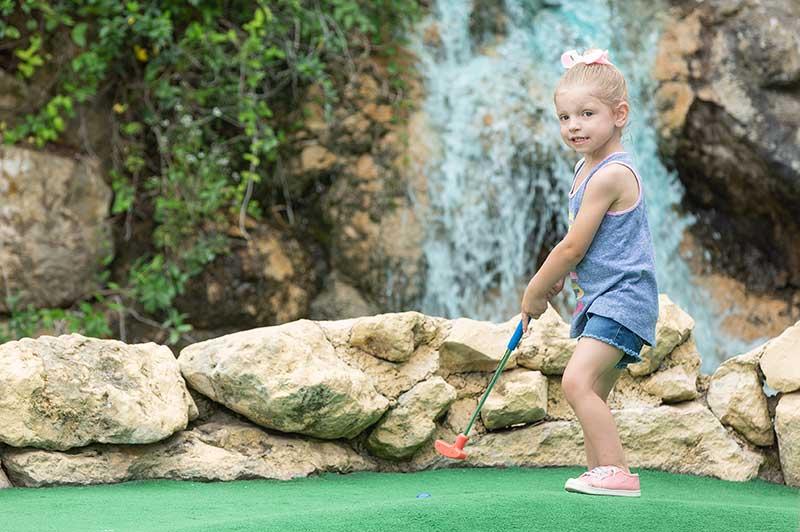 cute girl playing golf in san antonio tx